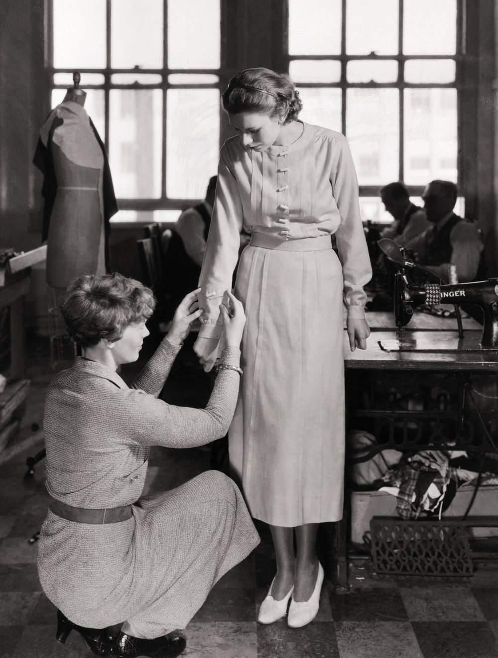 Amelia Earhart putting the finishing touches on a blouse. (Photo Courtesy of History.com and Getty Images)