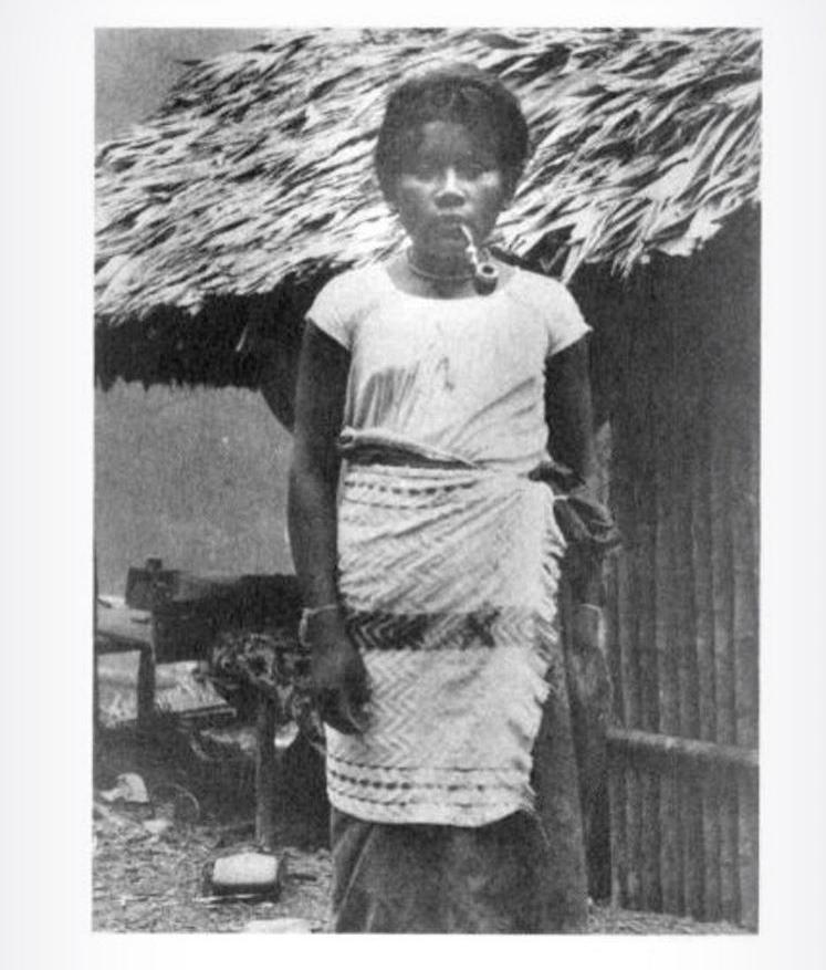 "Glass slide from Moravian mission slide show, with caption, ""A typical heathen girl (showing primitive skirt)"" circa 1930. Moravian Archives, Bethlehem, Penn."