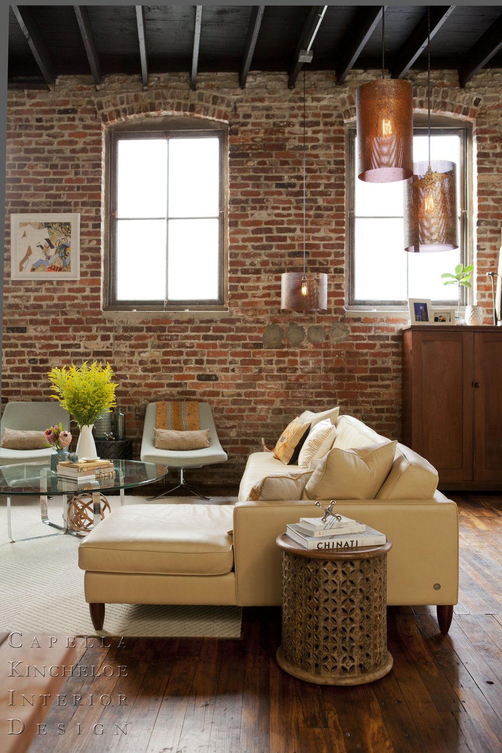 warehouse living in Atlanta, brick walls, American Leather sofa, Room & Board Chairs, open concept living