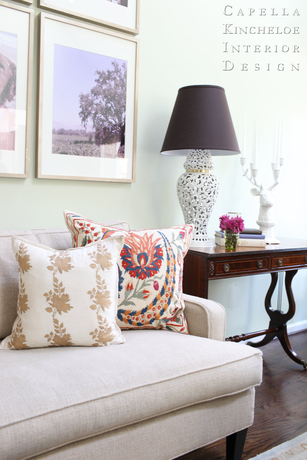 southern living room, suzani pillow, mint walls, custom photo art, black lamp shade