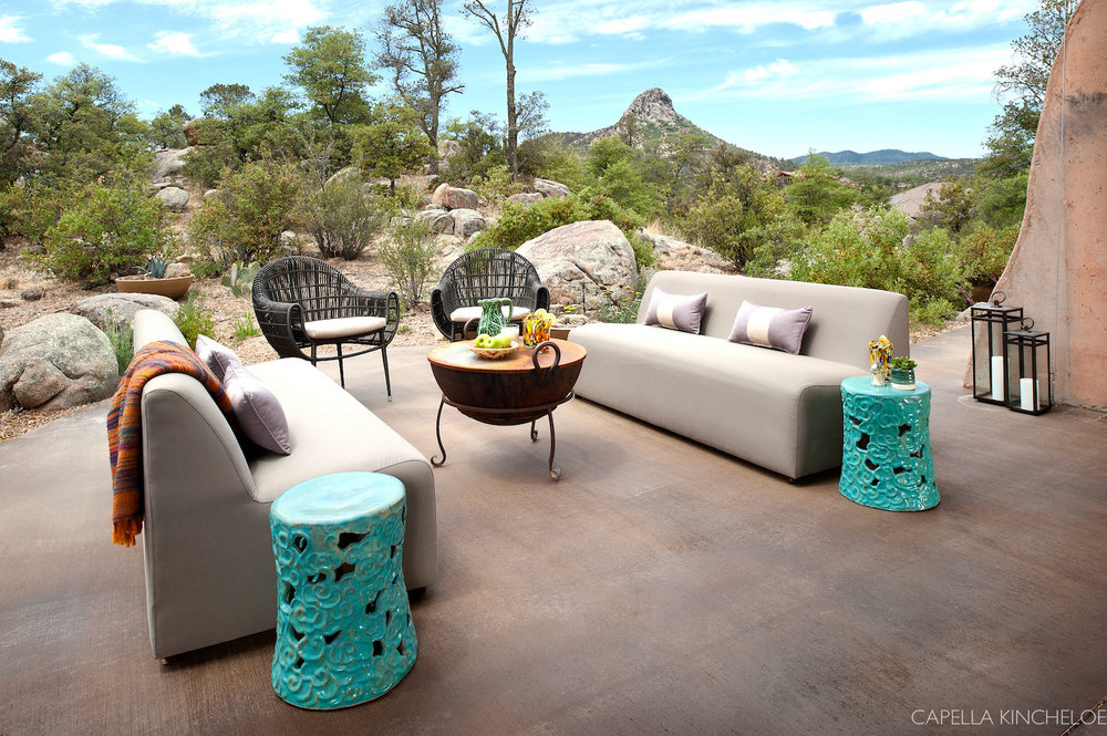 Exterior living room in Arizona.  Flows with the interiors spaces via a Nana wall.