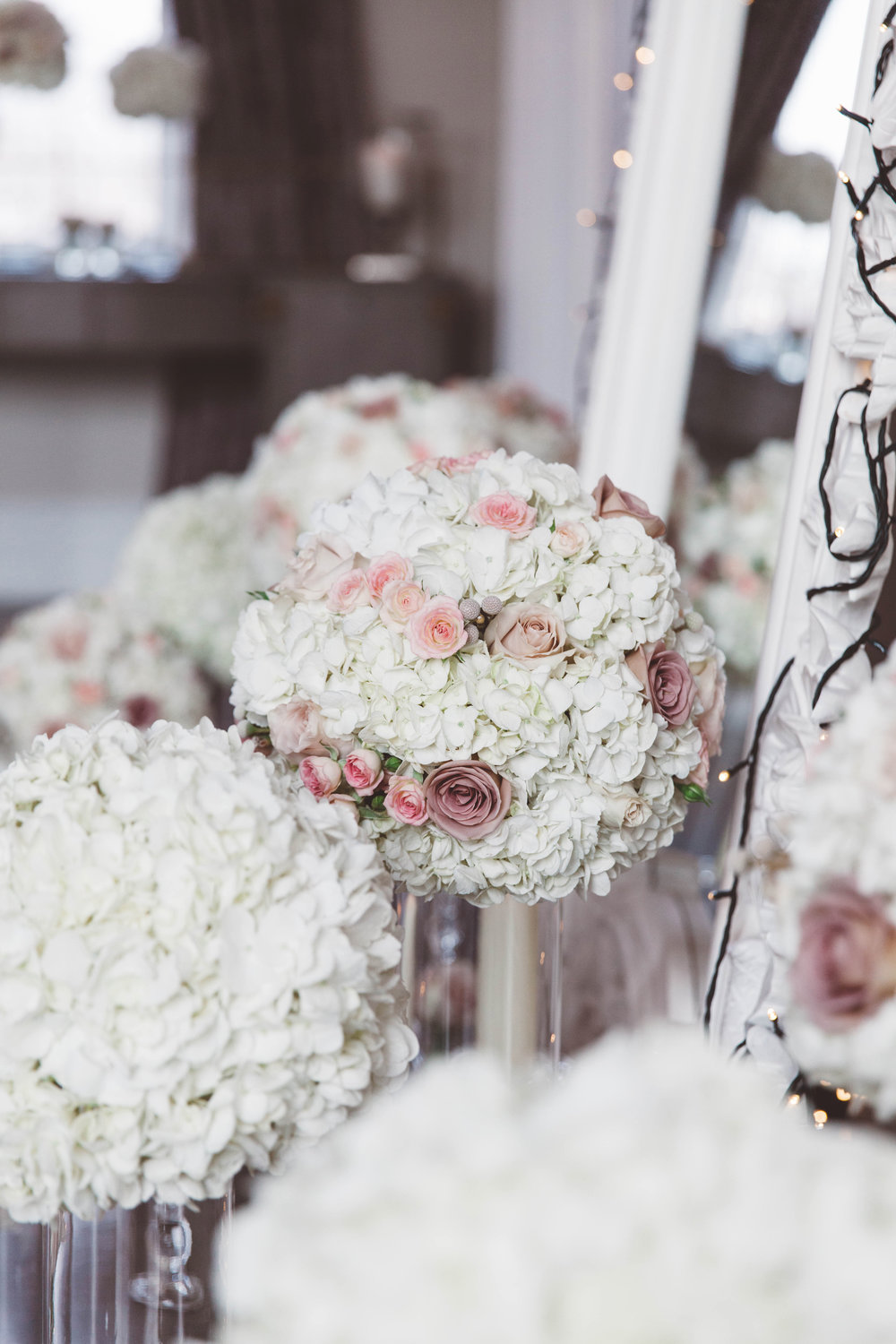 Soft pink and Hydrangea wedding floral displays at amalfi white, by award winning Derbyshire florist, Tineke