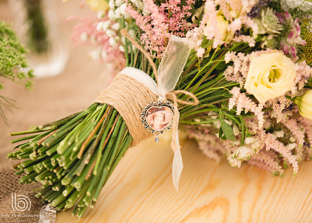 Hand tied bouquet by Tineke complete with sentimental picture for the bride