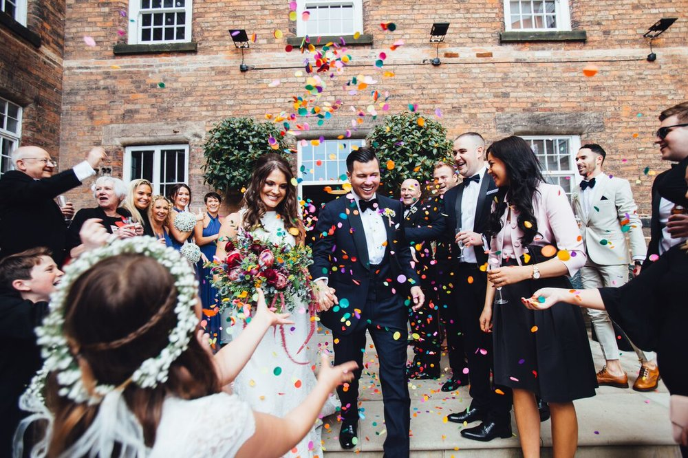 Confetti shot with bridal bouquet at West Mill Darley Abbey wedding venue.