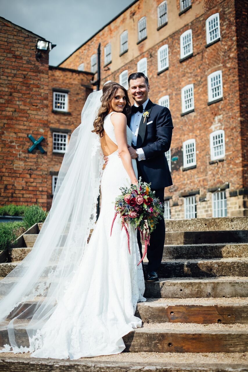 West Mill Darley Abbey Wedding Venue with vibrant bridal bouquet by Tineke Floral Designs