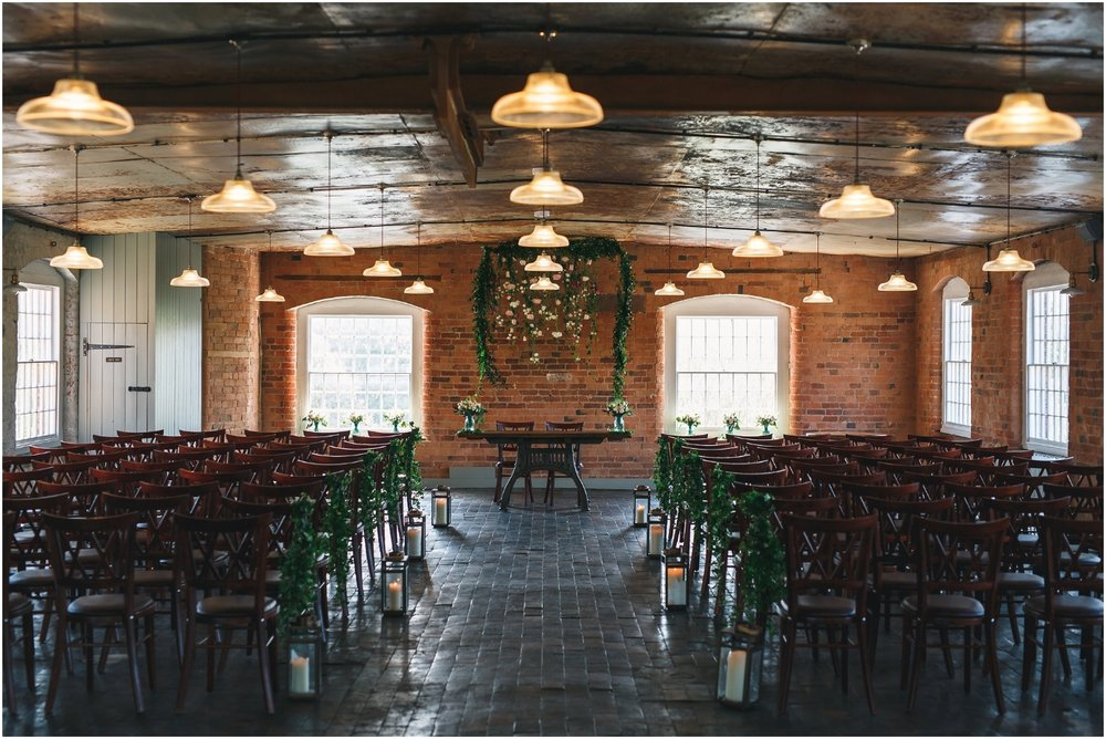Ceremony backdrop at West Mill by Tineke Floral Designs