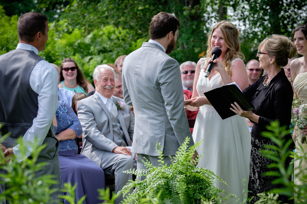 Rustic outdoor wedding ceremony at Stout's Island Lodge in Birch