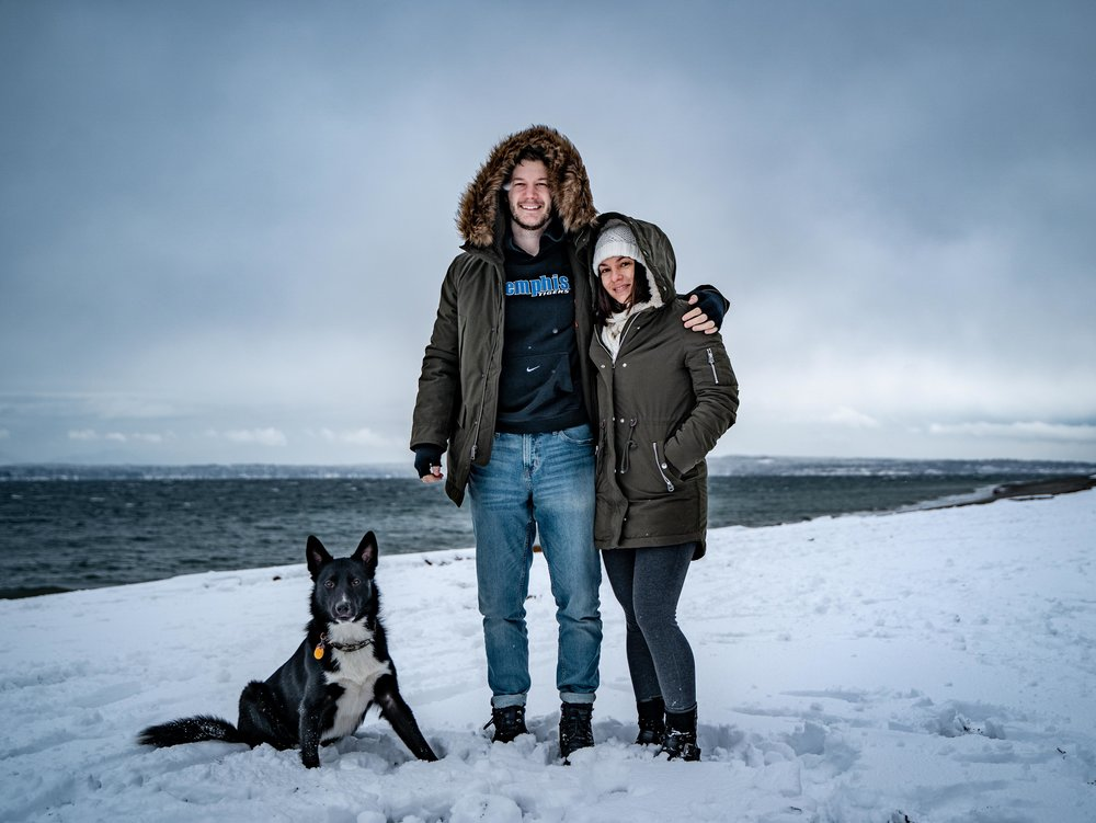 Family with Black and White Border Collie Shepherd Dog in the Snow