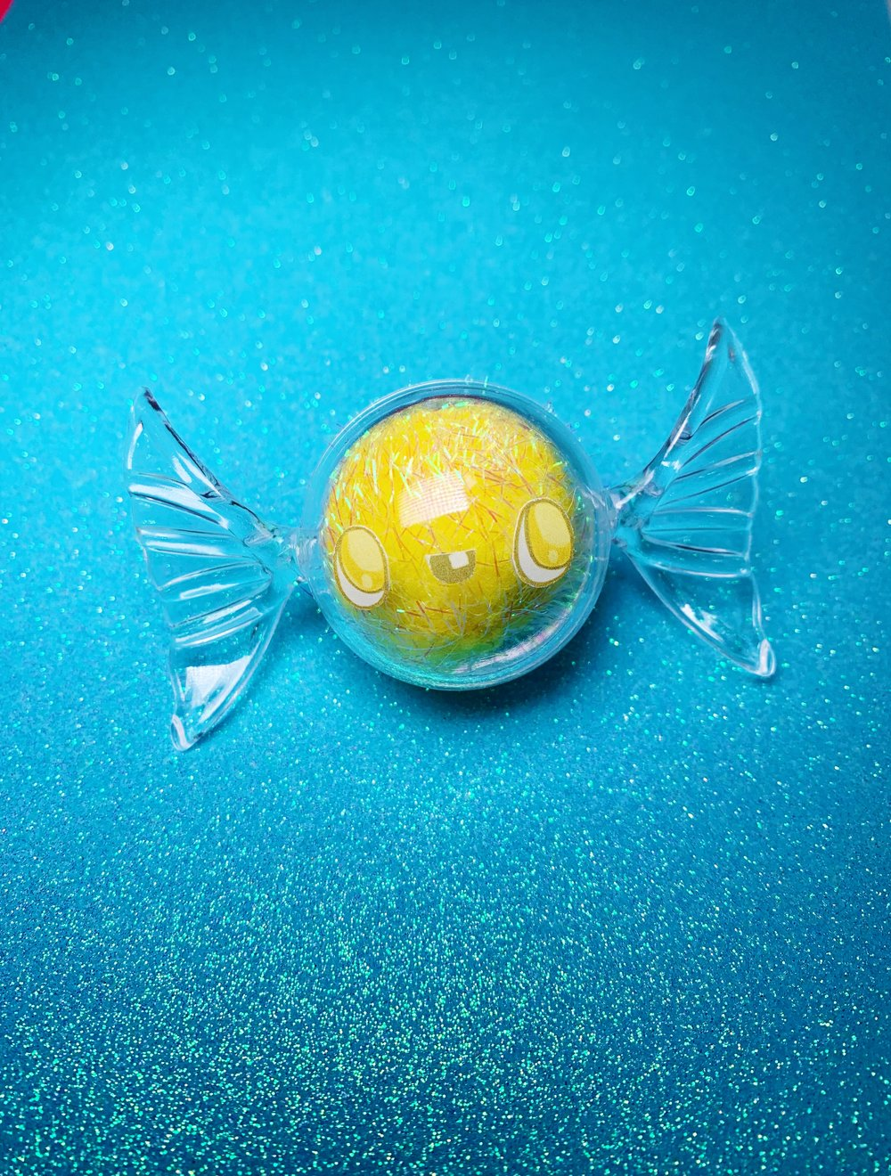 One of a kind yellow candy monster.
