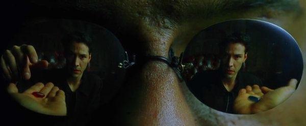 Neo takes the red pill in The Matrix (1999).