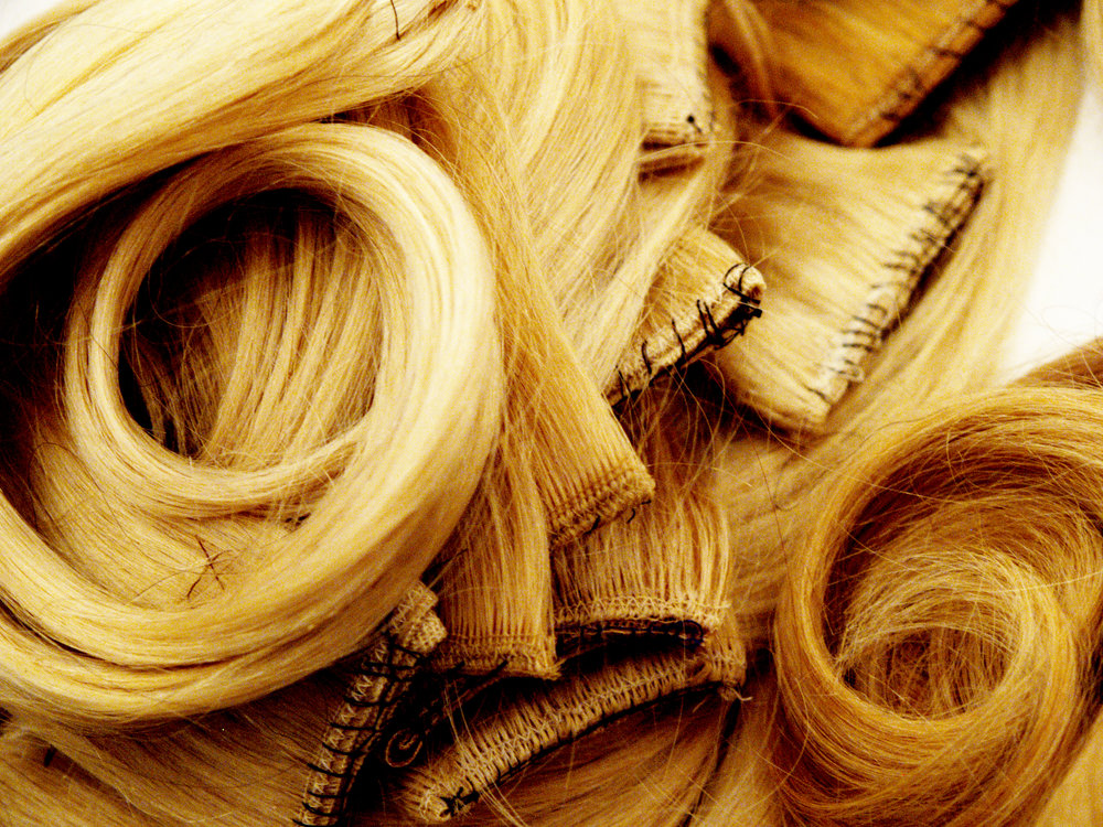 pile of hair extensions backstage at NYFW 2050065.jpg