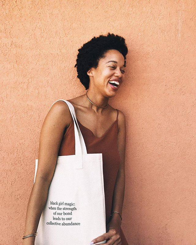 black girl joy. we're totally here for it. 🌸 this mantra on the back of our #blackgirlmagic bag still rings true. have you treated yourself to our latest + greatest. if not, be sure to explore our online shop. #vsco #ivoryandashlife