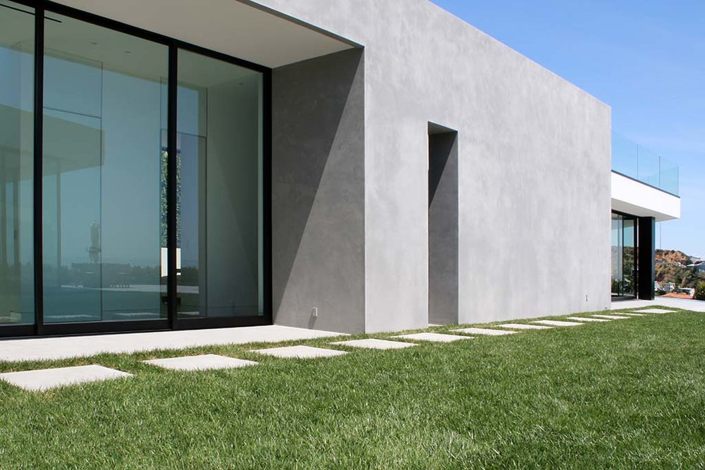 X-Bond Seamless Stone was used to resurface exterior walls