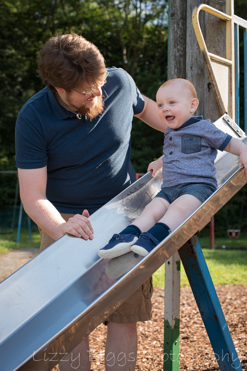 Daddy and Son on slide at the park