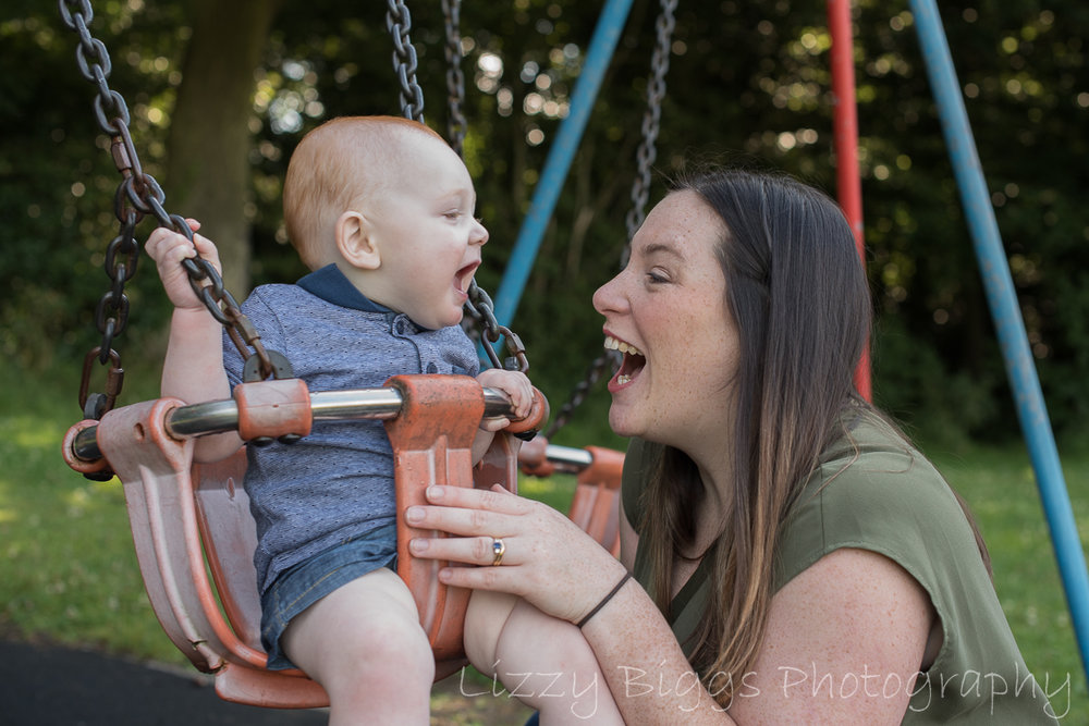 Mummy son moment swings bit smiles