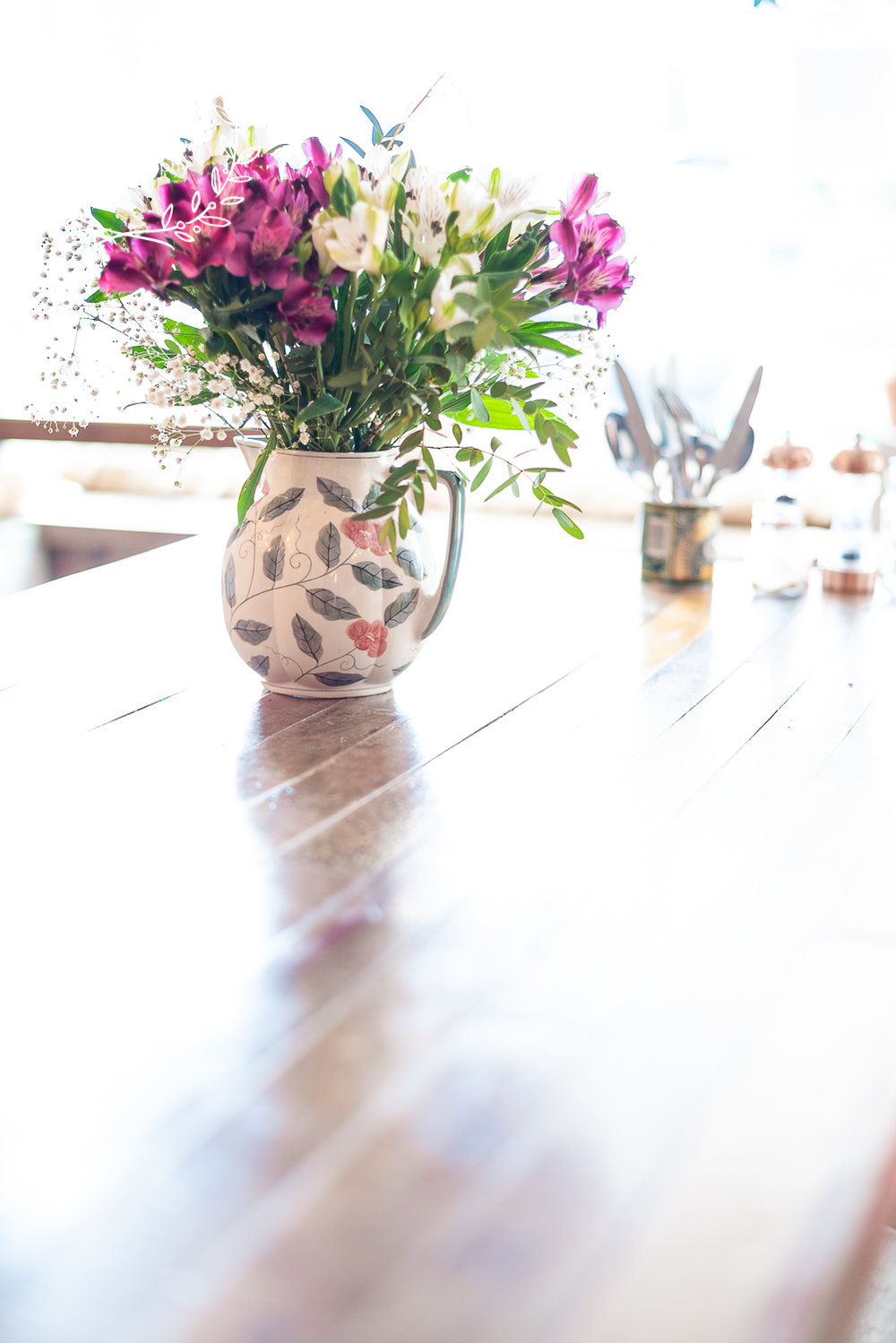 Lizzy_Biggs_Photography_reflection_of_flower_jub_on_table
