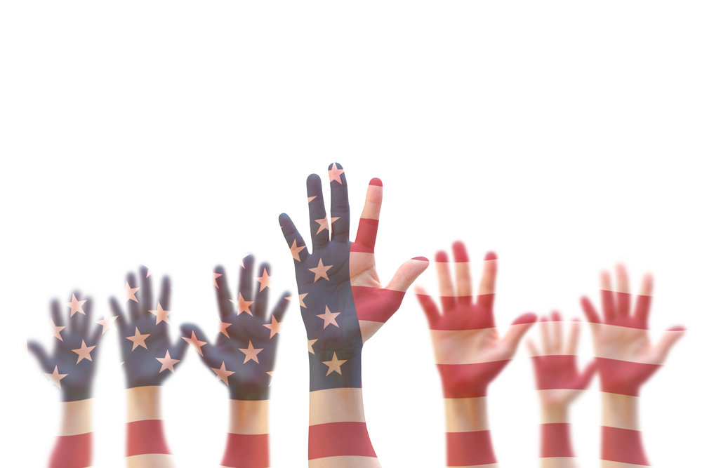 USA American flag pattern on people hands for voting, volunteering participation election, civil rights concept USA American flag pattern on people hands for voting, volunteering participation election, civil rights concept