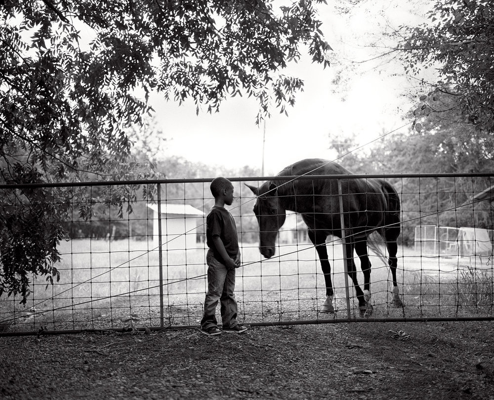 Jeremy and horse at the plantation.