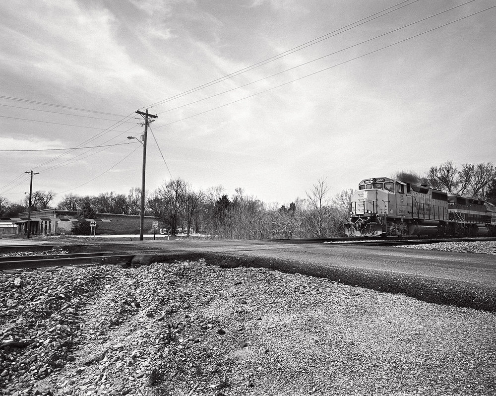 freight train passing through the village of crawford, levon's neighborhood.