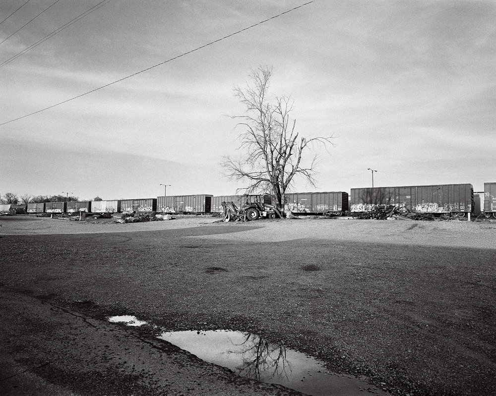 main street artesia, abandoned train across from the social clubs.
