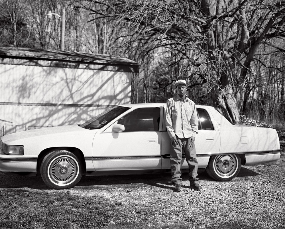 kennedy's nephew tedric at home with his cadillac.
