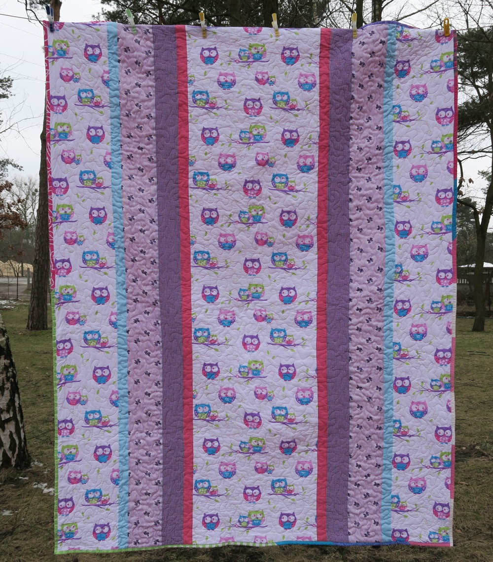 04 Owls.  A year or so ago I found almost a whole bolt (60 meters) of this owl fabric on a local auction site for about $100.  I bought it and am still using it up in charity quilts. I've basically wiped out my all my misc. purples, pinks, and coordinating blues.