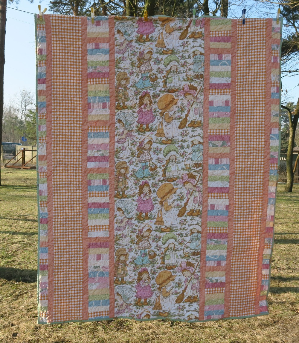 18 Sarah Kay.  This curtain fabric with a girl named Sarah Kay was very appealing to me. I ended up making 4 quilts from it. The designer of the fabric is actually Australian, as I understand it. These were curtains that I picked up for about $3 as second-hand fabric. The design is too big to cut up. so I made it a panel front. Sweet.