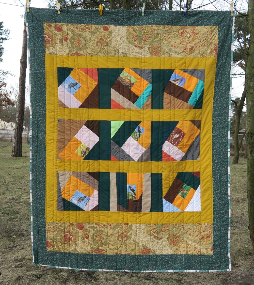 19  Crazy quilt top donated by a group in FL. The top was only a lap quilt size, but I find that I really need single or what I call European twin size. So, I added borders until it fit the size I needed.