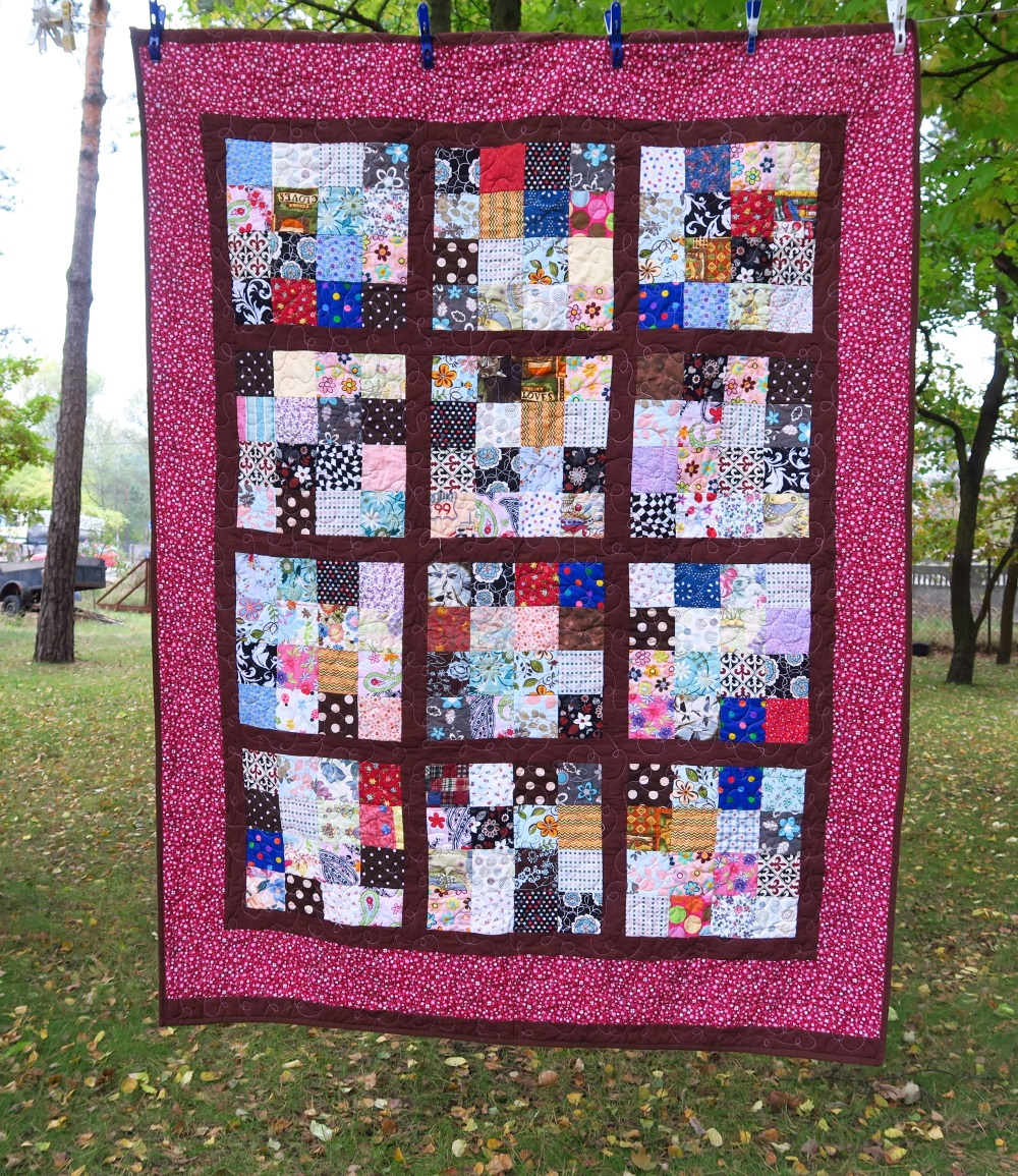 92 Misc. squares sashed in brown and bordered in a burgundy