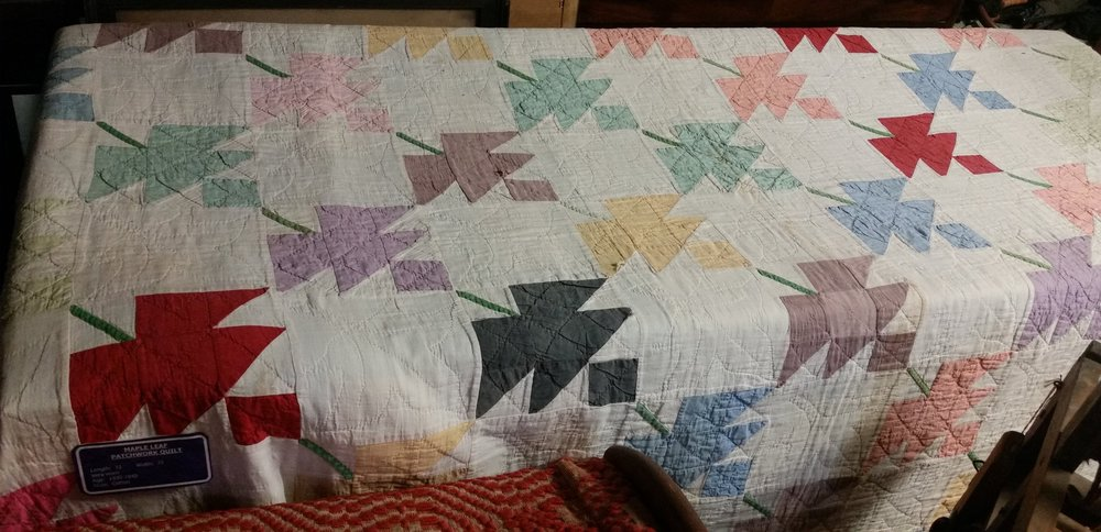 Dated 1930 to 1940 and called a Maple Leaf Patchwork Quilt.