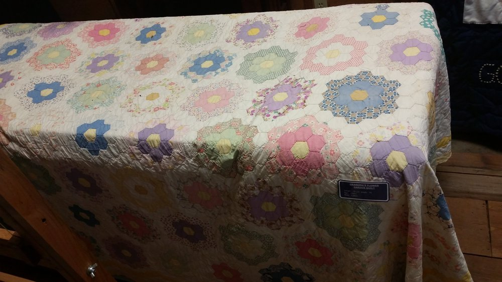 From the 1930's. This quilt is called Grandma's Flower Garden.