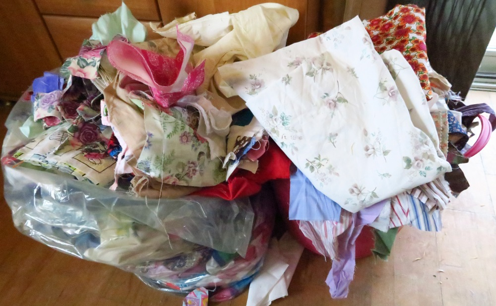 This is my most immediate goal.  I'm going to try to get rid of the pile that is located int he pink plastic laundry tub by tomorrow night, midnight.  The rather large piece of printed fabric is leftover from the latest quilt top I've finished but not written about yet.