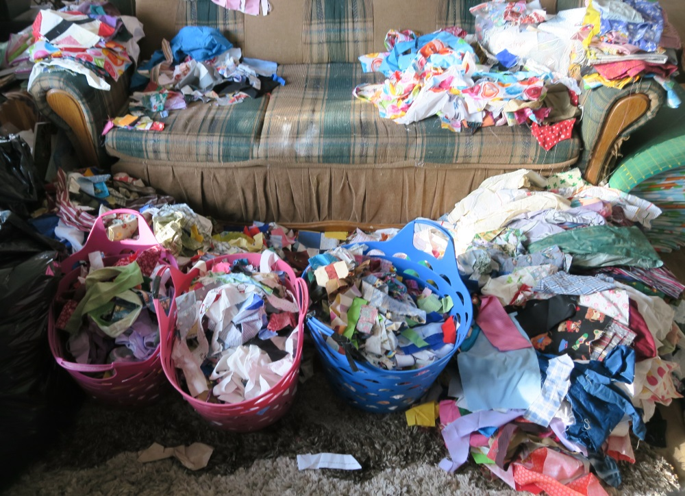 This is actually the living room. For a change, I left the table and sat on the sofa to sort. I had to decide/sort the scraps/strips that were all jumbled up together and crumbs. What a mess!