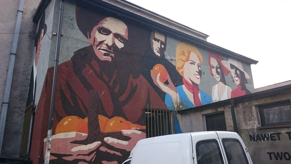 This mural is painted on the side of a building across from the memorial shown below.