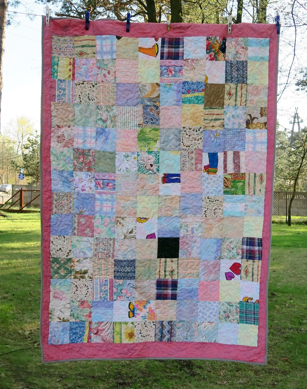"30. Various 6"" pastel/floral squares made into a quilt."