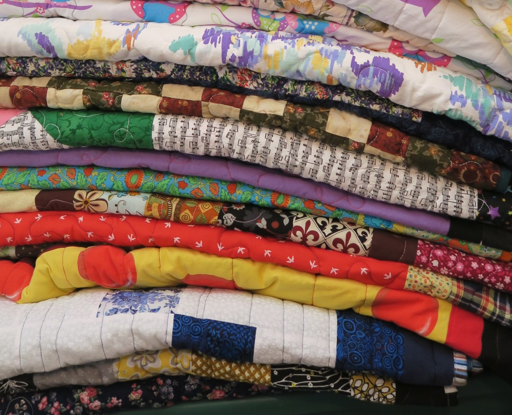 Here's a picture where you can see a variety of quilting styles - from uneventy spaced lines to stippling, and loop de loops.