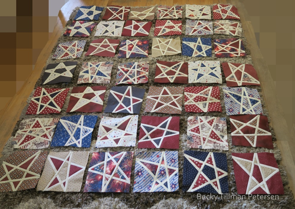 This was before the final layout. I was trying to mix up reds, and then the busy backgrounds, spread the blues around, change the direction of the stars. I had help with a student who was at our house for dinner - he moved some around as well.