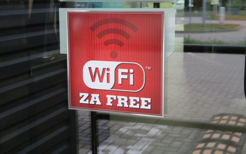 "In Polish they pronounce ""WiFI"" as ""VeeFee"", so this is pronounced ""VeeFee za free"".  It's kind of a tongue twister. And no, ""free"" isn't a Polish word!"