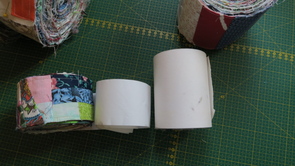 "The wider tape is on the right - it is almost 4"" wide. The other adding machine tape is about 2"" wide."