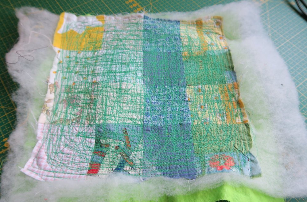 "This QAYG (quilt as you go) block came back from the sewing machine repair place truly ""quilted to death"". No doubt they used it to test the machine after they replaced the sensor!"