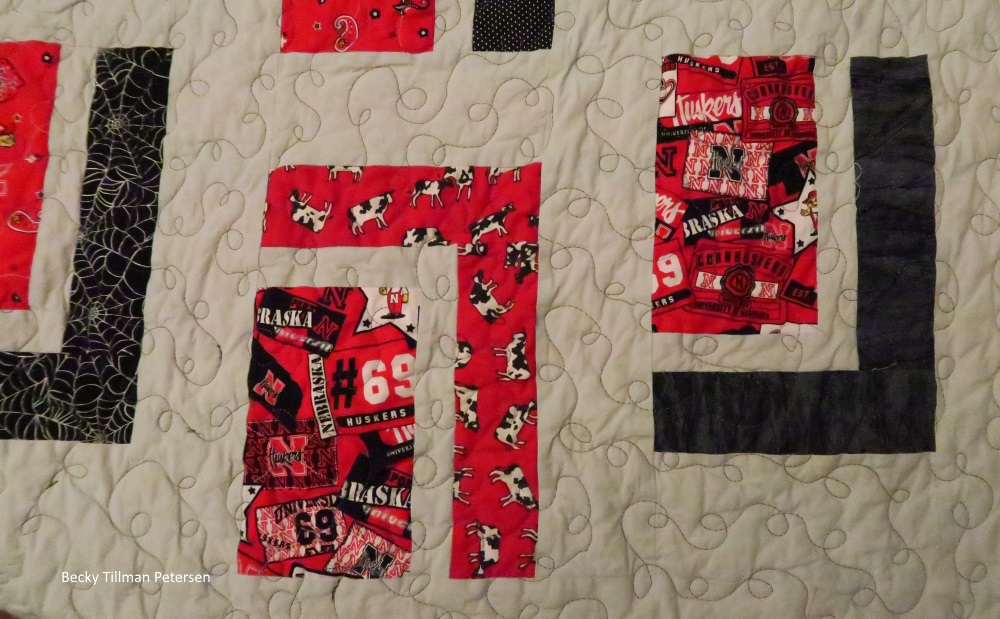 The cows fabric surrounding one of the fabrics I had. I used up every possible inch of it in this quilt (that larger Huskers print. I was really kicking myself that I hadn't bought at least a yard. Lesson learned.