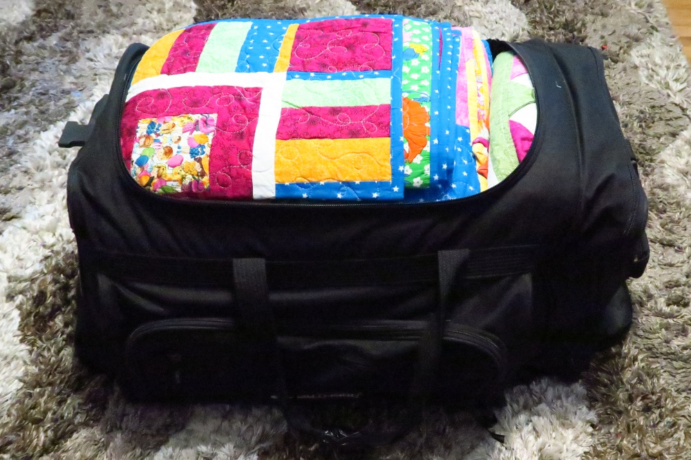 "After.  11 quilts in that bag - though only 6 are ""bigg-ish"" - 3 twin, 1 full and 2 queen. Three are commonly called lap quilt size with only one a baby quilt size."