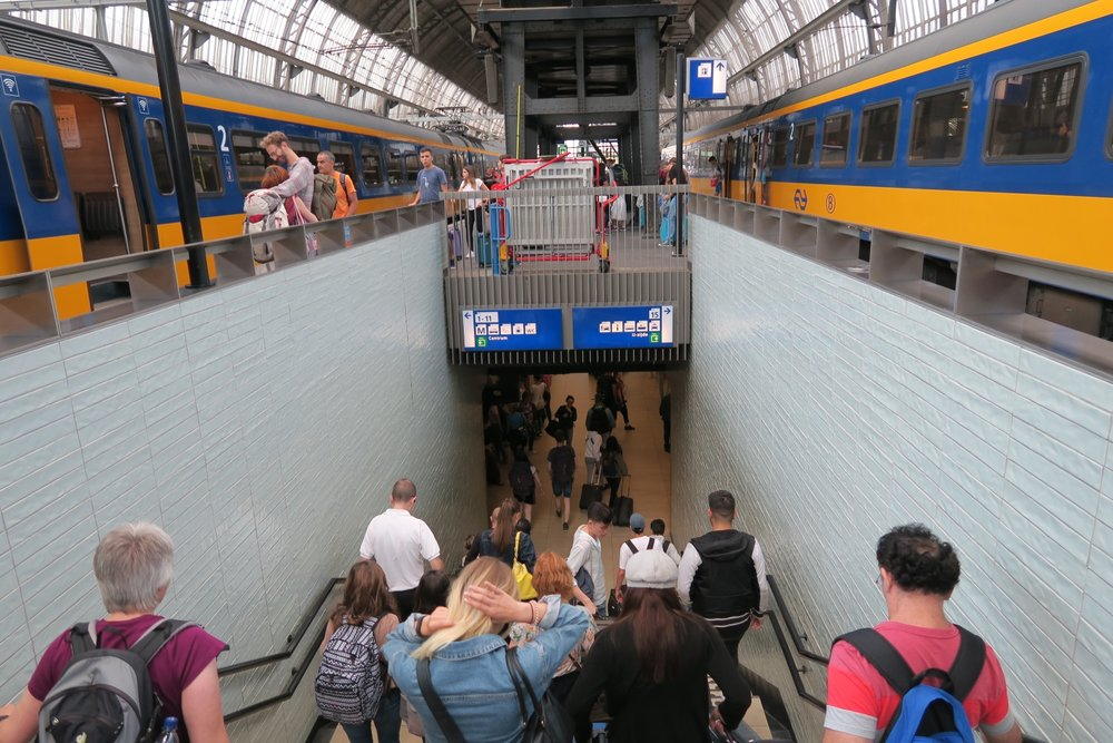 As you get out of the train, you head underground to get to the other side of the train tracks.