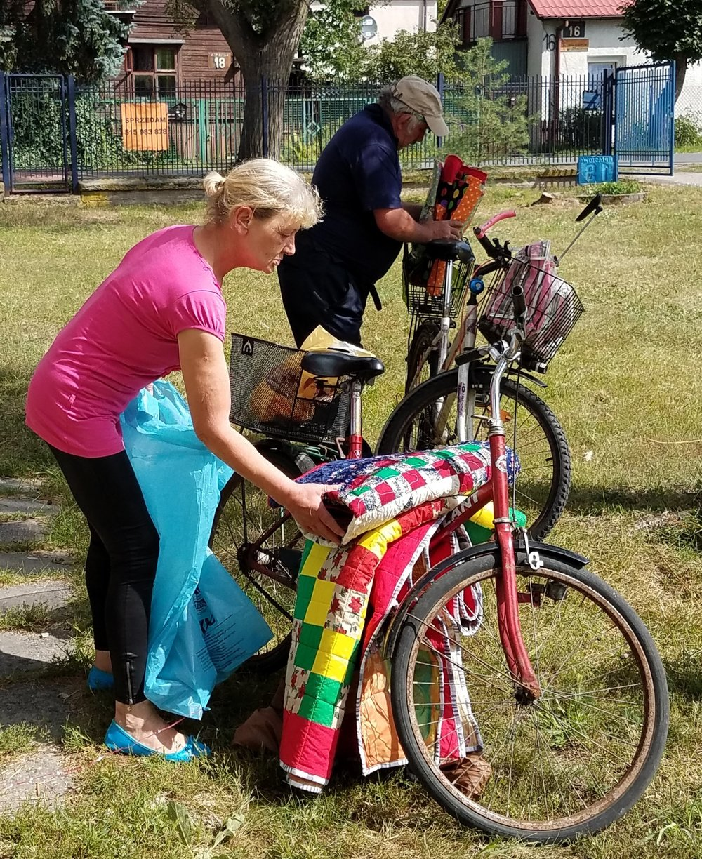Here are some people packing up their quilts on their bikes. This was the most common form of transportation we saw today.