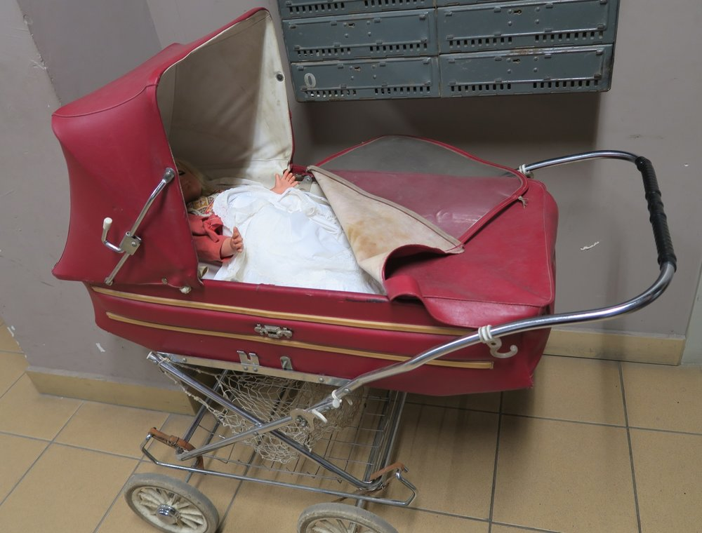 An old fashioned stroller. We'd probably call it a baby buggy.