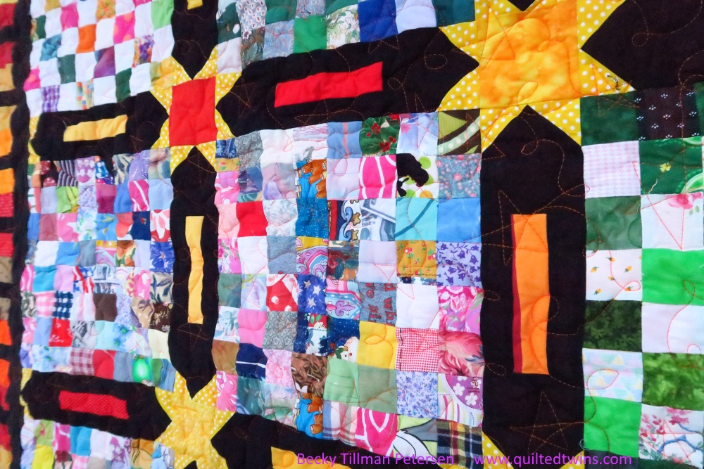 Picture of explosion quilt, a quilt with a starlike emblem in the center