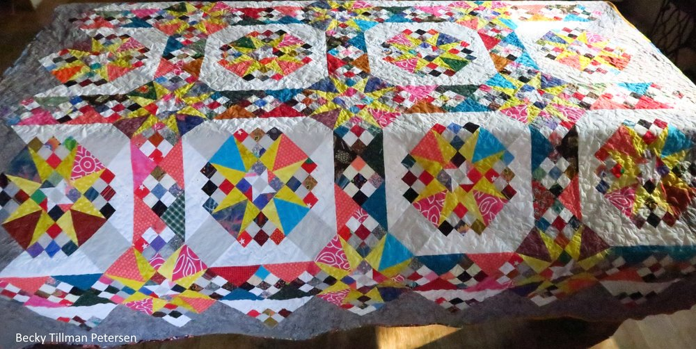 picture of quilt test pattern # 49, a quilt with a triangle-square mixture of patterns giving the impression of stars