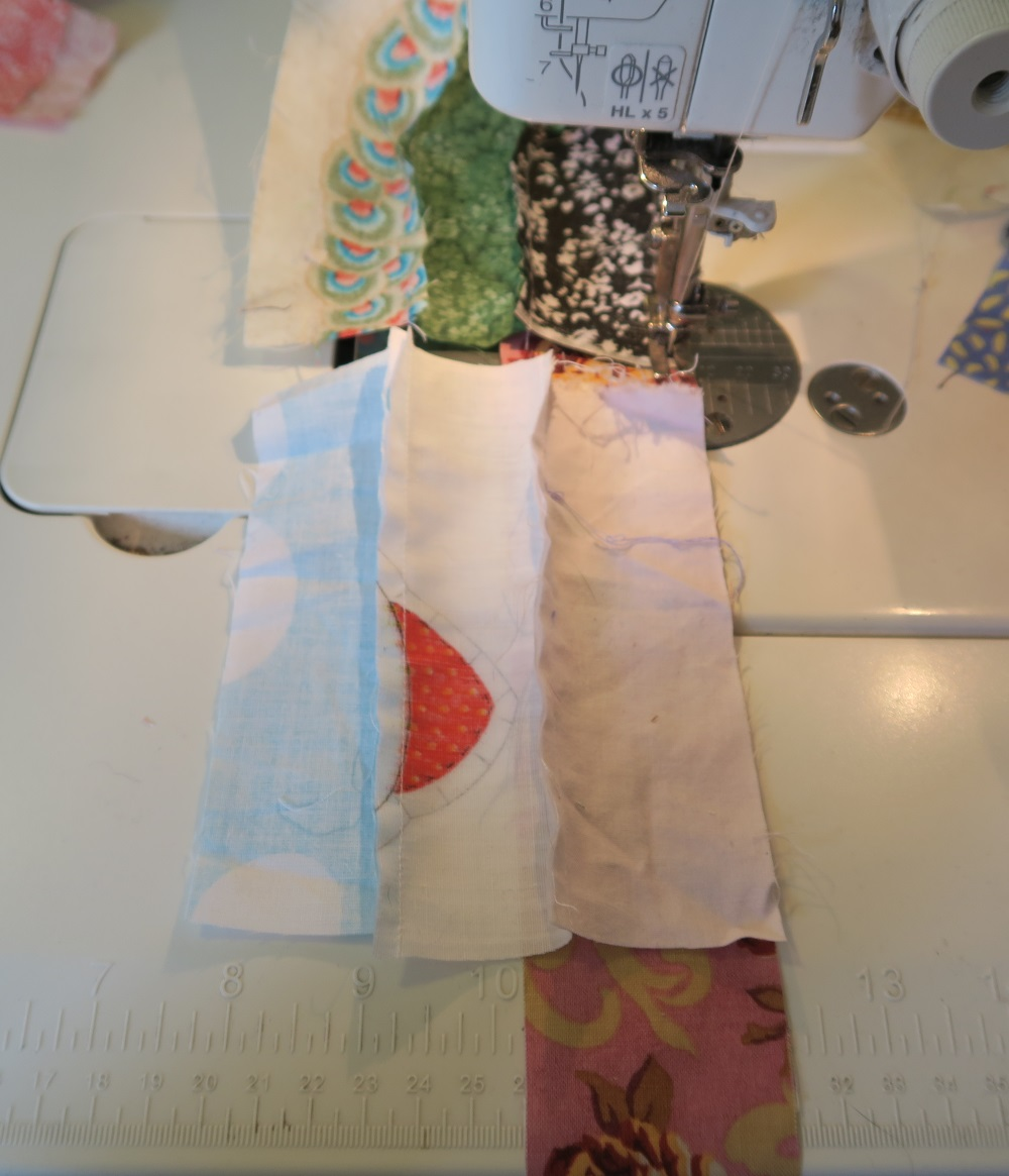 You can use any method you wish to sew them together - in this case after I get about 3 strips on, I tend to use a long strip and sew it like this to the shorter ones.