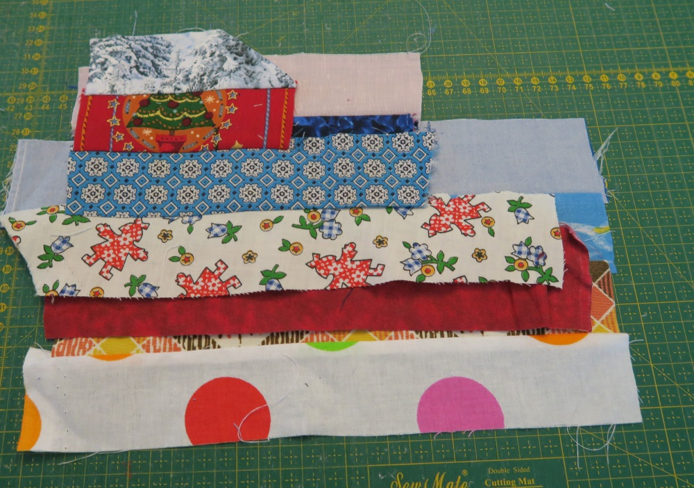 Line up several on top of each other, staggering so that the actual seam lines aren't right on top of each other. Make for easier cutting that way.
