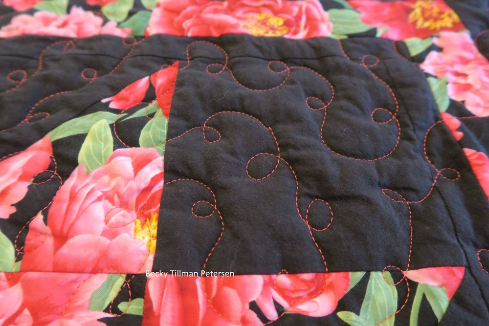 close up of the black border revealing a tiny sewing pattern